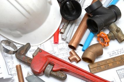 Plumbing parts, tools, and plans used by Gary's Plumbing, Inc..